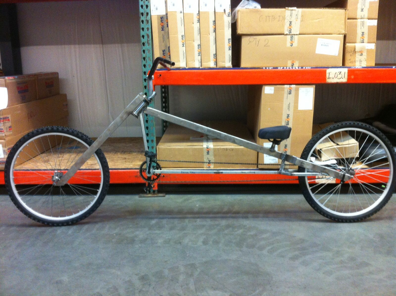 stretch cruiser made from scrap metal and an old bed frame found in a dumpster this custom bike is long with a chain and wheels
