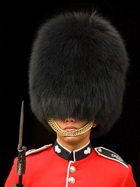 queen s guard london london why do they have to wear such a huge