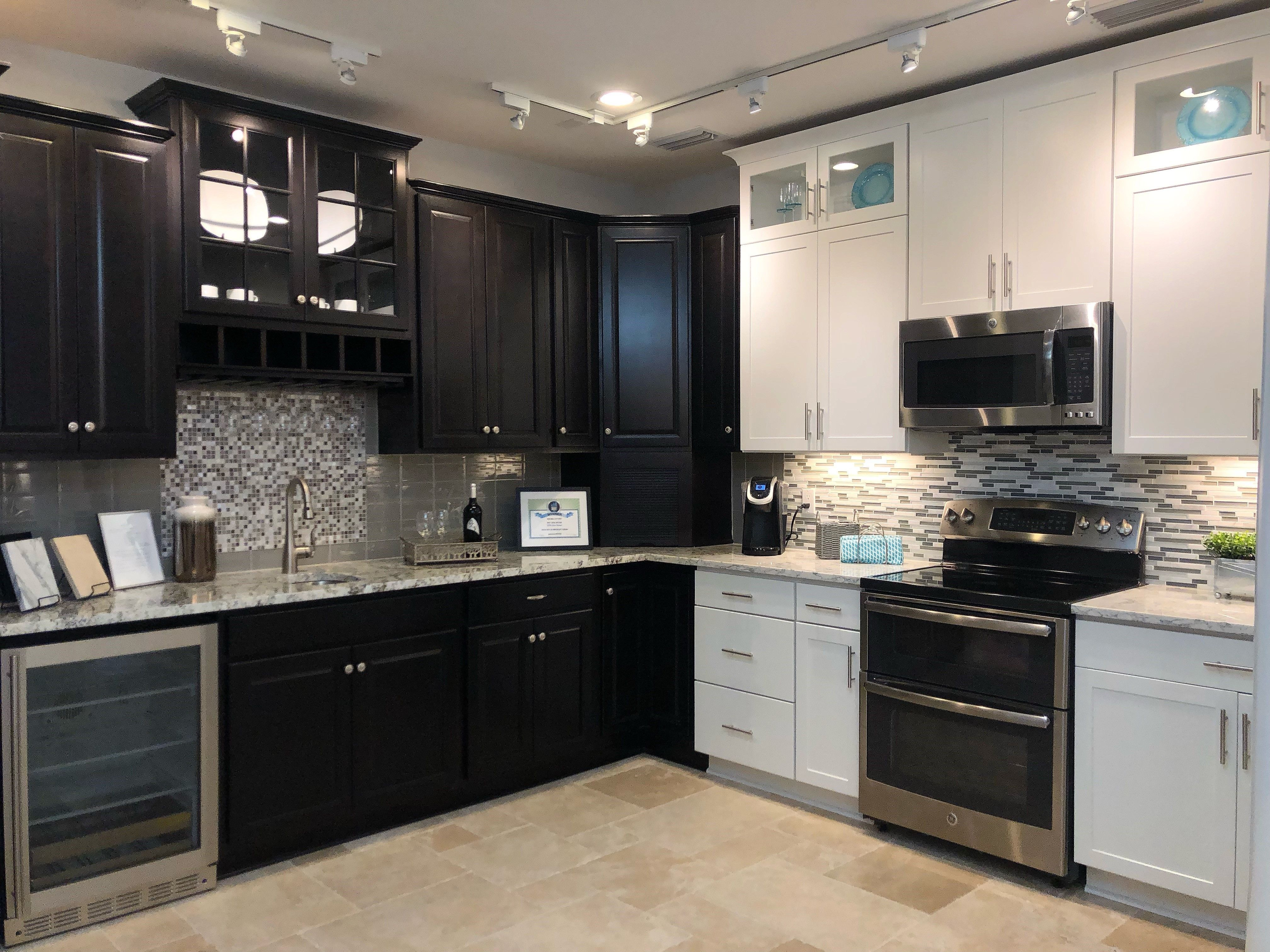 Which Cabinets Would You Choose From Our Design Center Sarsaparilla Or White Custom Home Designs House Design Cabinets And Countertops