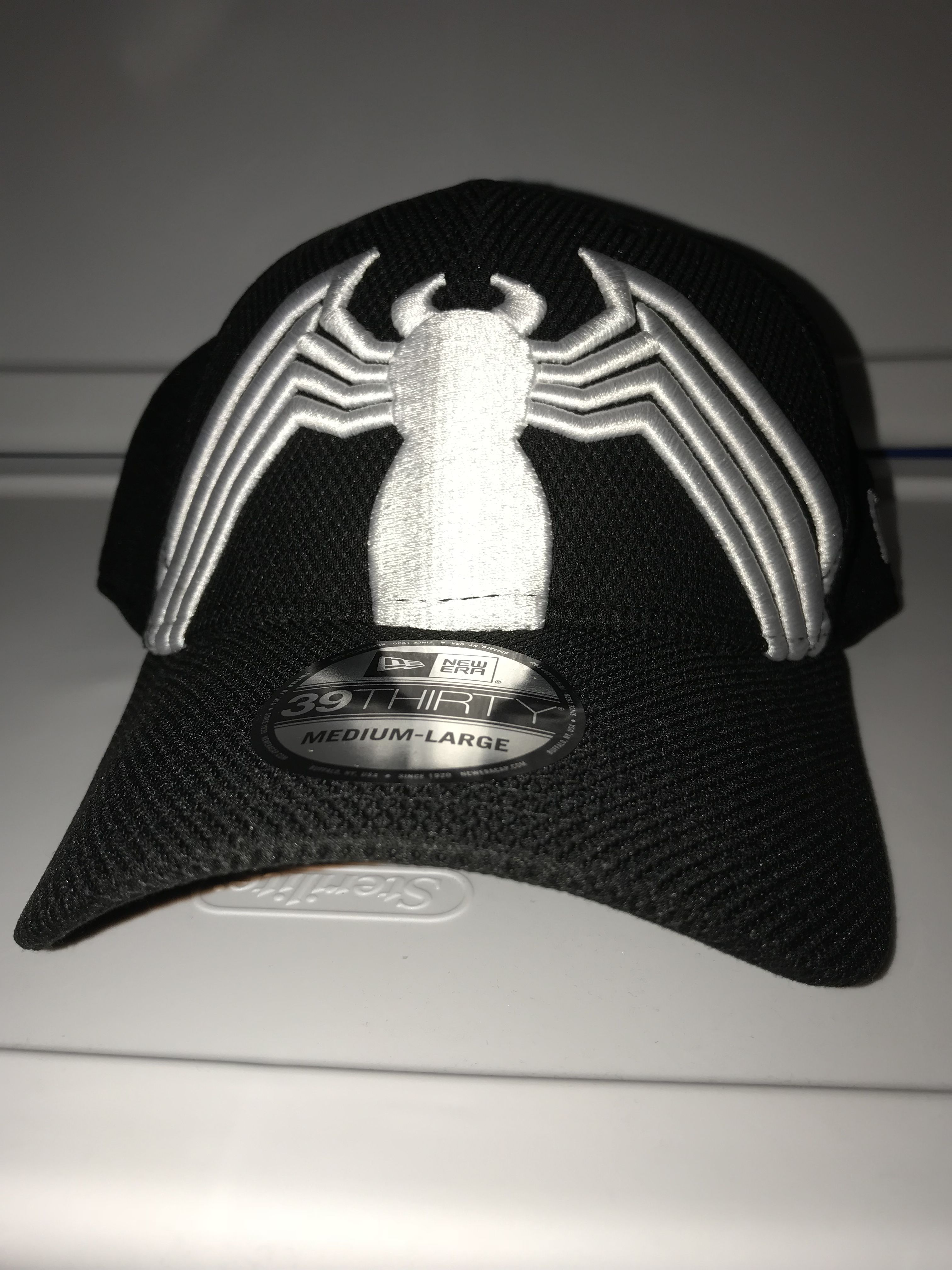 5631bf42198 New era Marvel Spiderman black suit symbol on front and back 39THIRTY