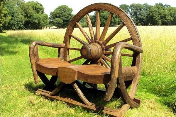 Rustic Rocking Bench constructed of parts from Wagon Wheels and Ox Carts with Teak Wood