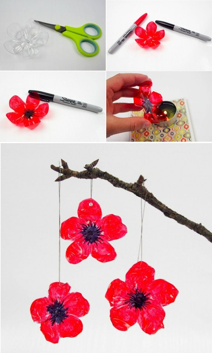 Do It Yourself Deko diy deko rote blumen aus plastik ast schere kerze schwarzer