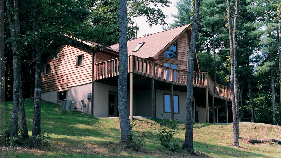 Sun Valley log cabin kit at 1592 sq. ft. has big glass front window ...