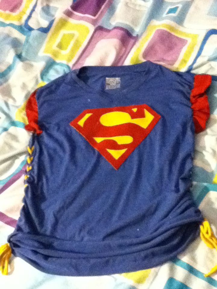This is a shirt I made for superhero day at school. Sorry about the few white spots near the neckline my white out spilled.
