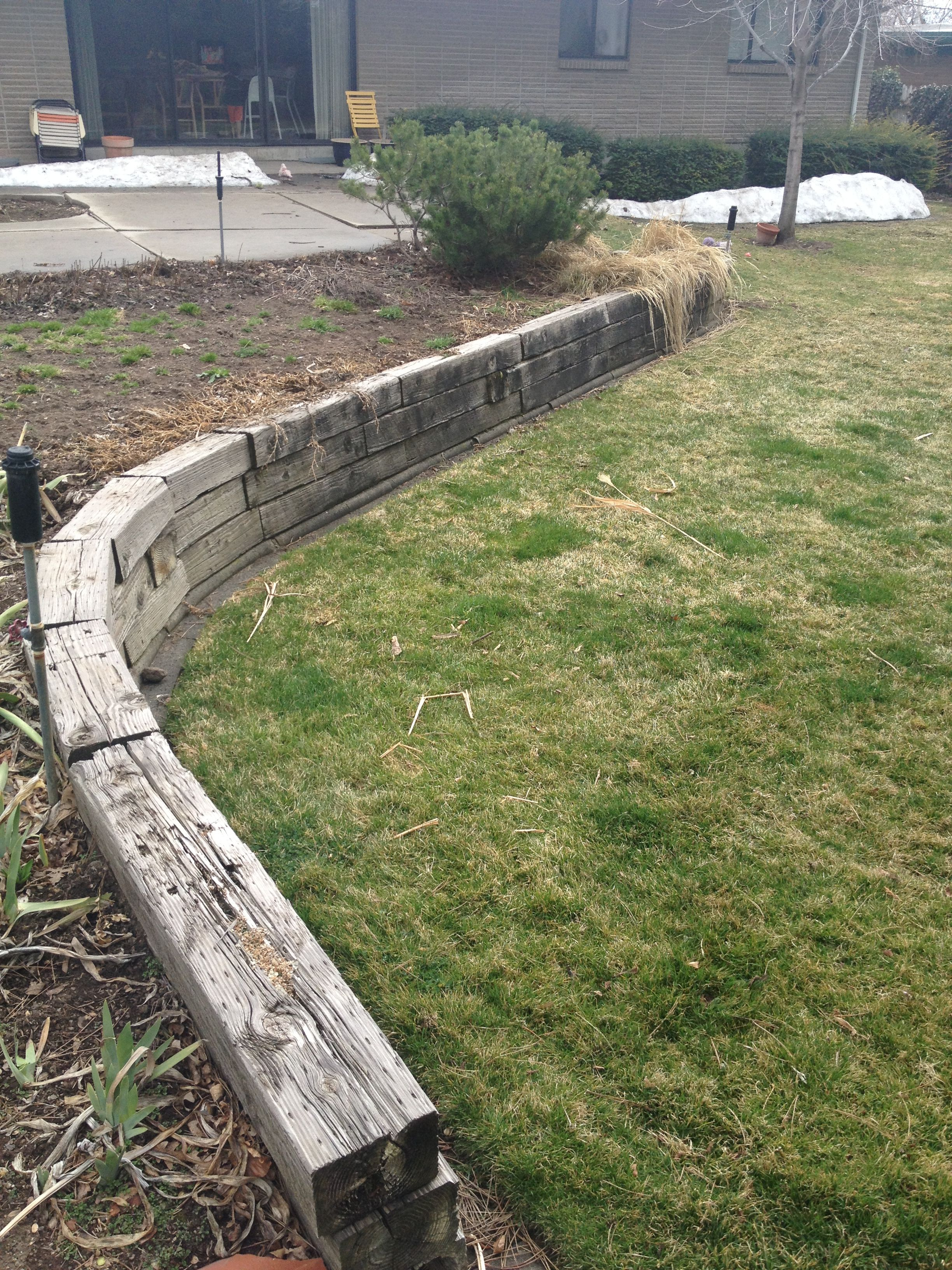 Remove old railroad ties  Replacing with large boulders for