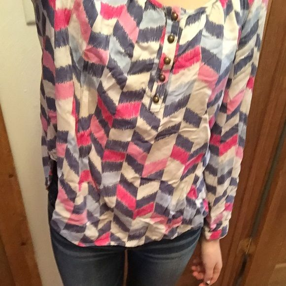 Cute, flowing shirt from JCPenny Adorable pink, blue and cream Cole combo. Ability to wear sleeves long, or 3/4. Bronze button detail on sleeves and top of blouse. Worn once. Willing to work with you on price! jcpenney Tops Blouses