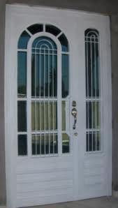 Proteccion De Herreria Para Puerta Buscar Con Google Puertas De Aluminio Modelos De Puertas Puertas De Entrada