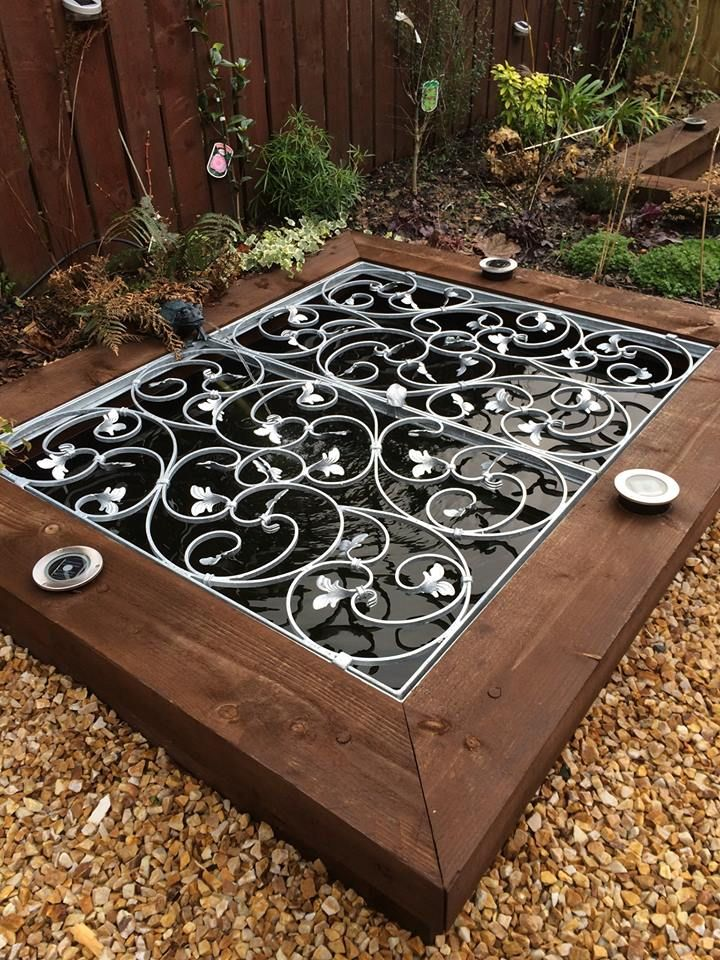 Pond safety cover designed by terra firma gardens in for Garden pond safety covers