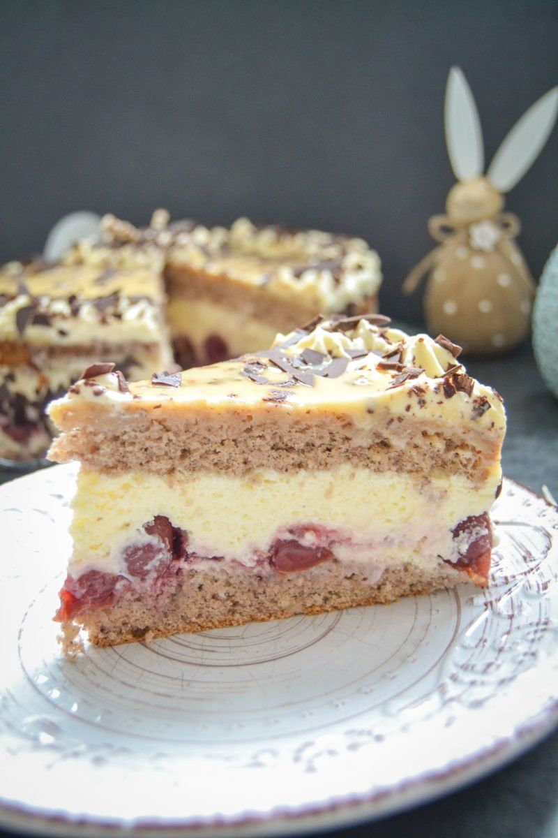 Photo of Grandma's delicious eggnog cake with cherries and walnut base
