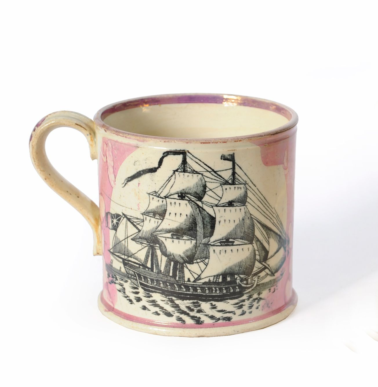 A Sunderland Lustre Pottery Mug, High Level Bridge Newcastle Upon Tyne, circa 1850. Printed on one side with a view of the bridge, titled, within splodged pink borders, on the other with a three-masted man o'war, C shape strap handle. I am in serious love with this mug! I need it!