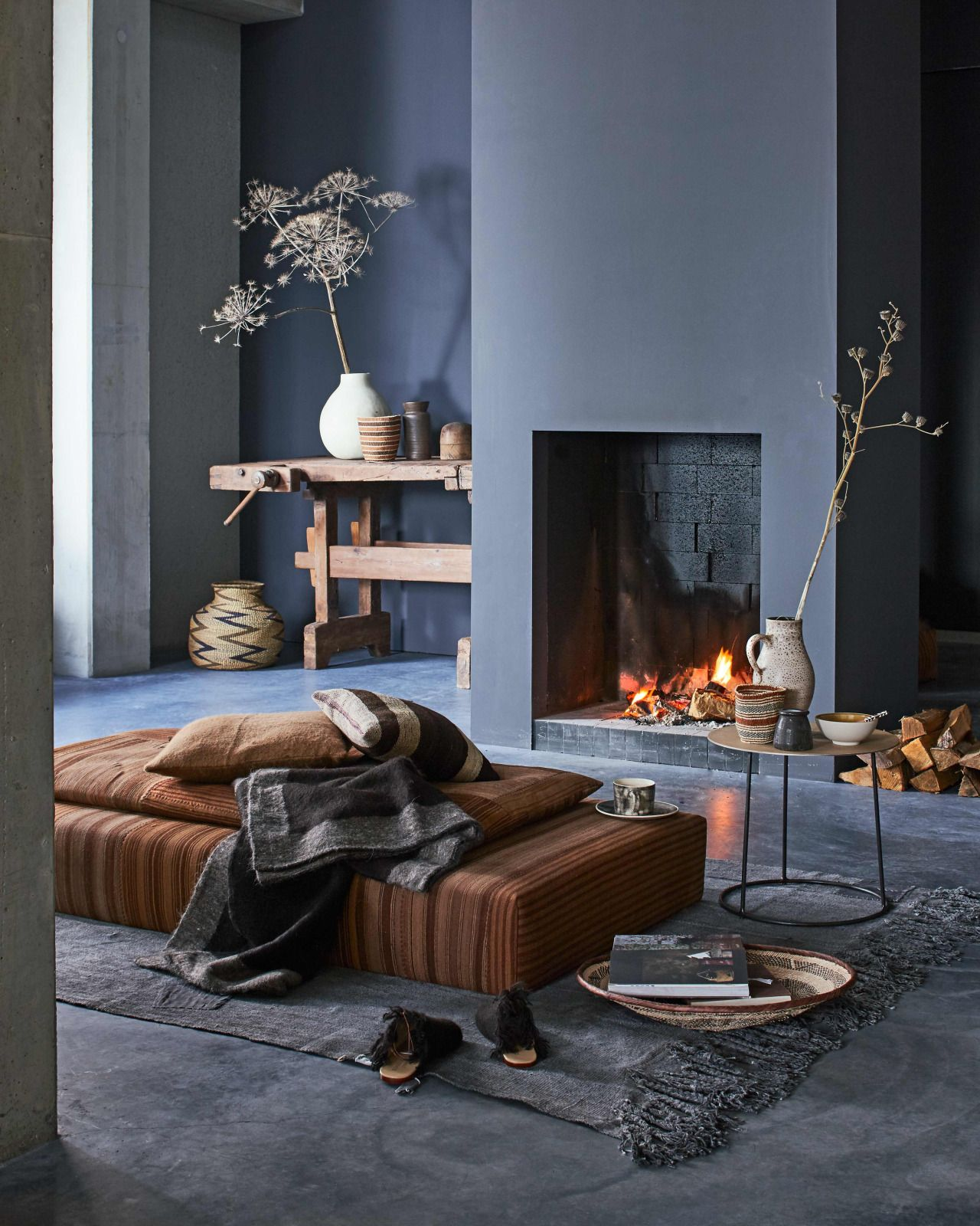 Contemporary design living room blue sofa twipik - Cozy Living Room In Warm Colors With A Fireplace