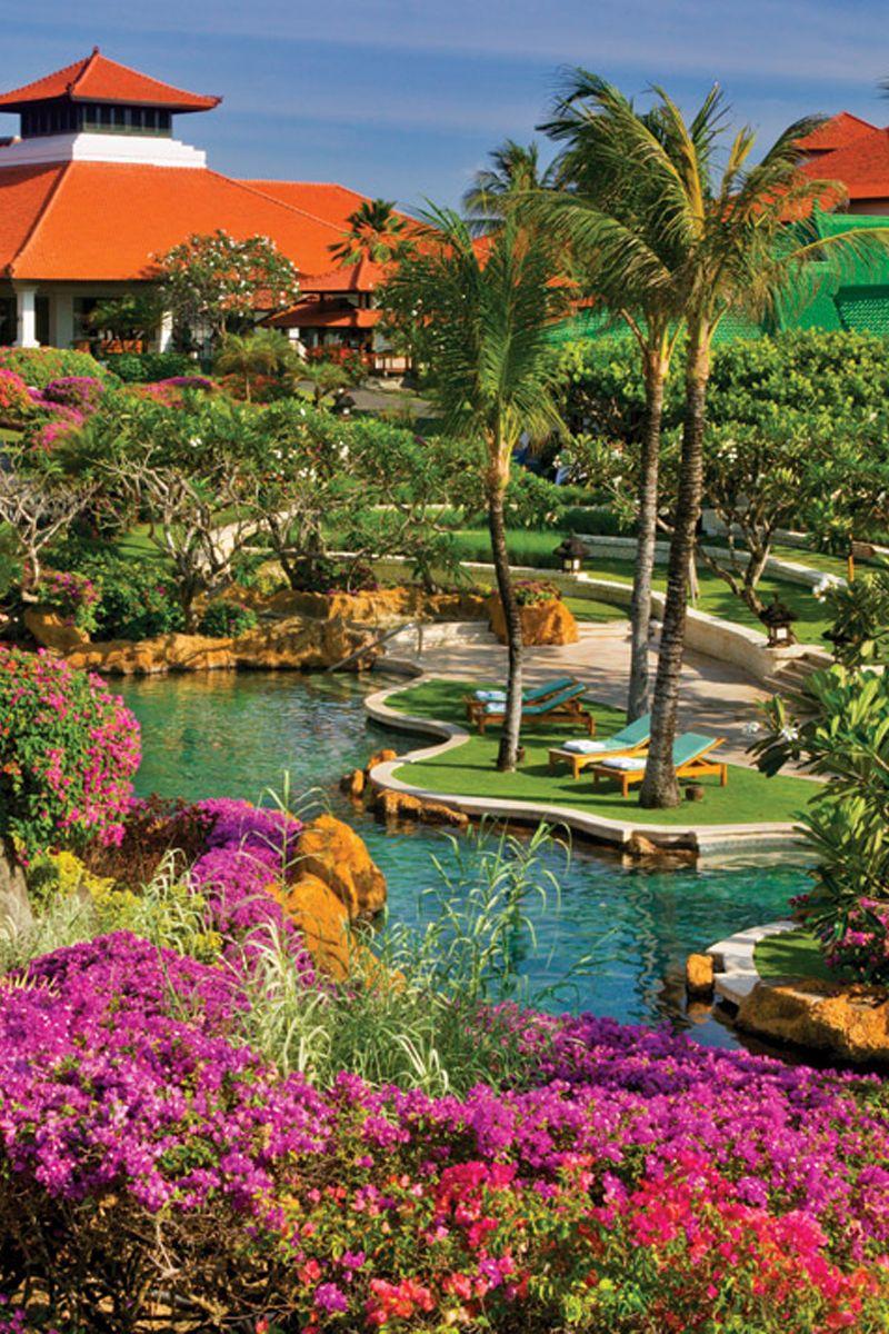 Pretty gardens surround the resort at Grand Hyatt Bali. Learn more ...