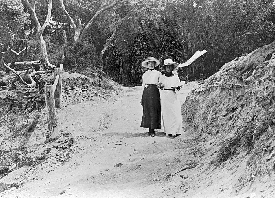 Description Of Content: Two women on the 'Spooks' footpath. The women are wearing hats and dresses typical of the Edwardian era
