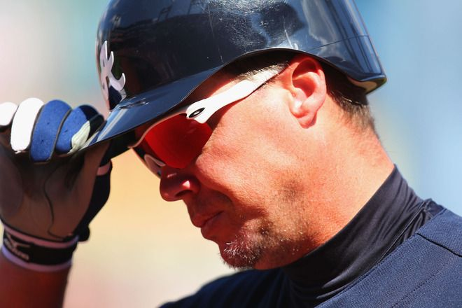 Chipper Jones returns to the dougout after striking out against the St. Louis Cardinals
