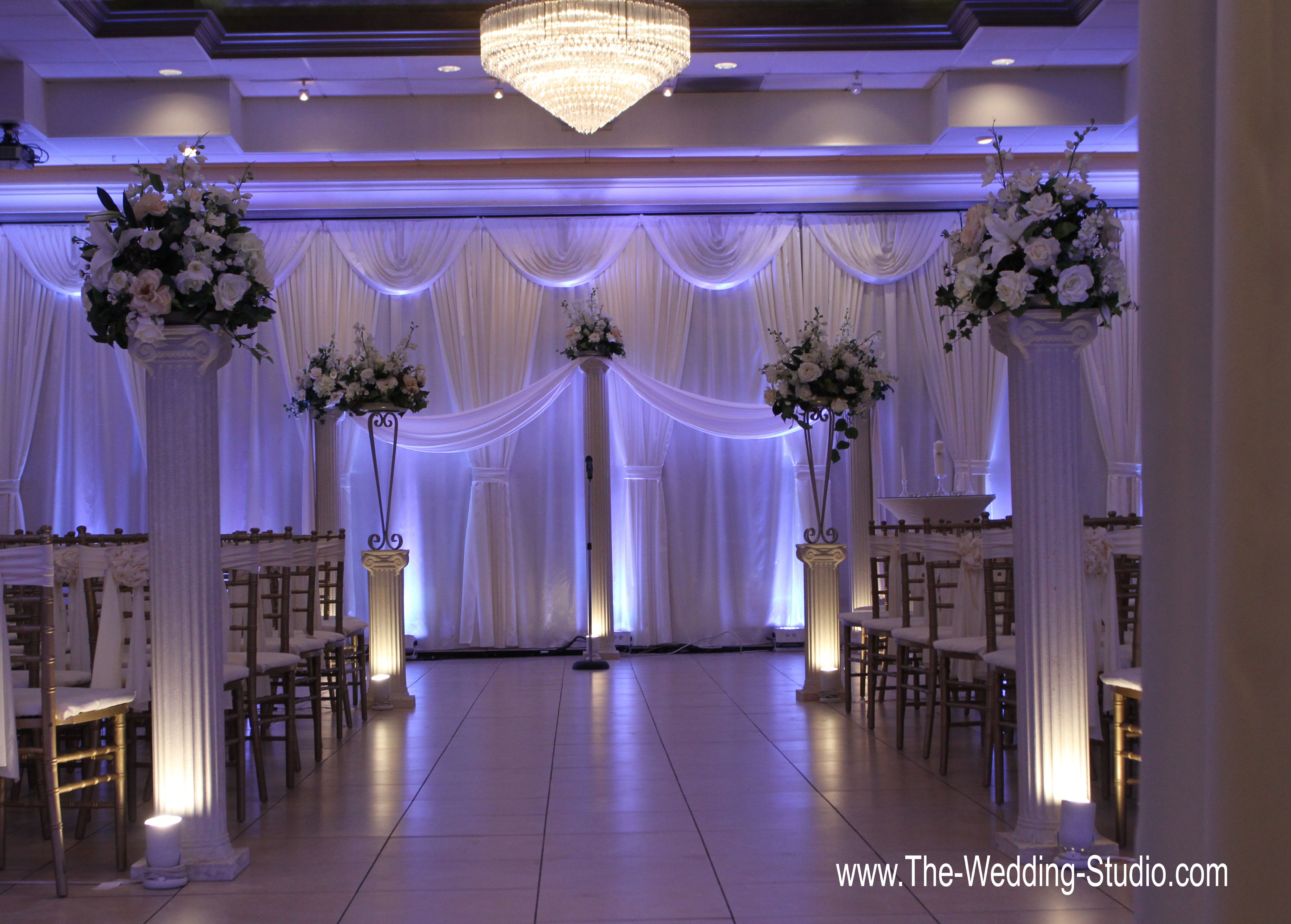 Purple up-lighting elegance added to the ceremony room at ...