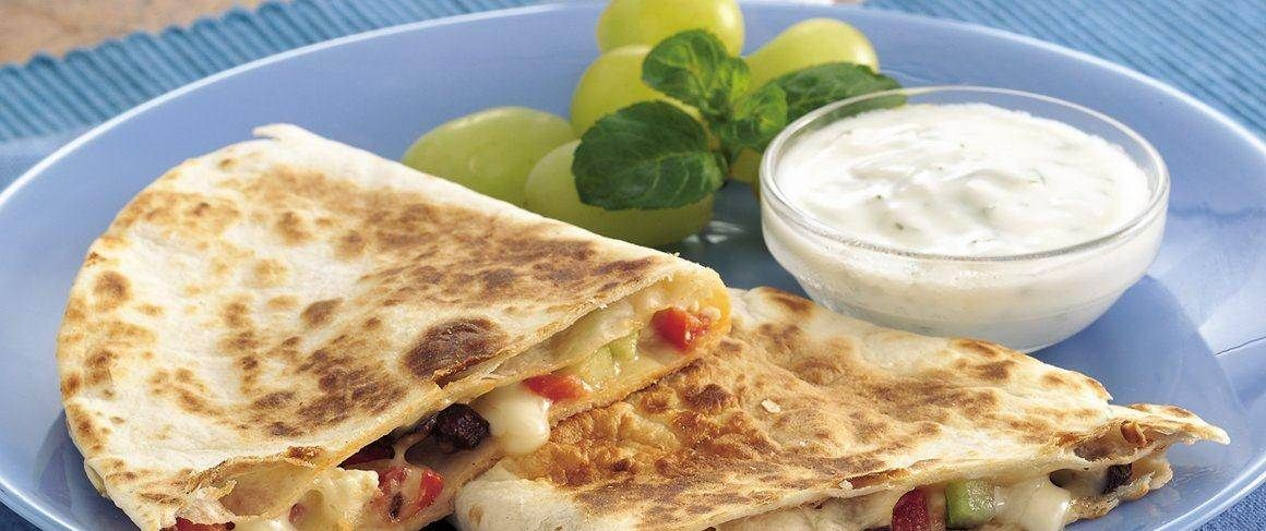 Quesadillas go Greek with a meatless salad filling.  Traditional dill-yogurt sauce makes a tasty topper.
