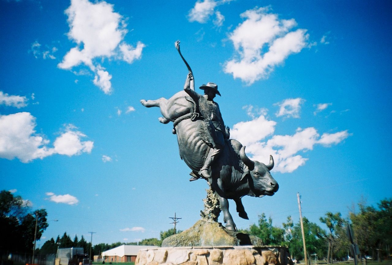 BULL RIDER STATUE AT THE FRONTIER PARK