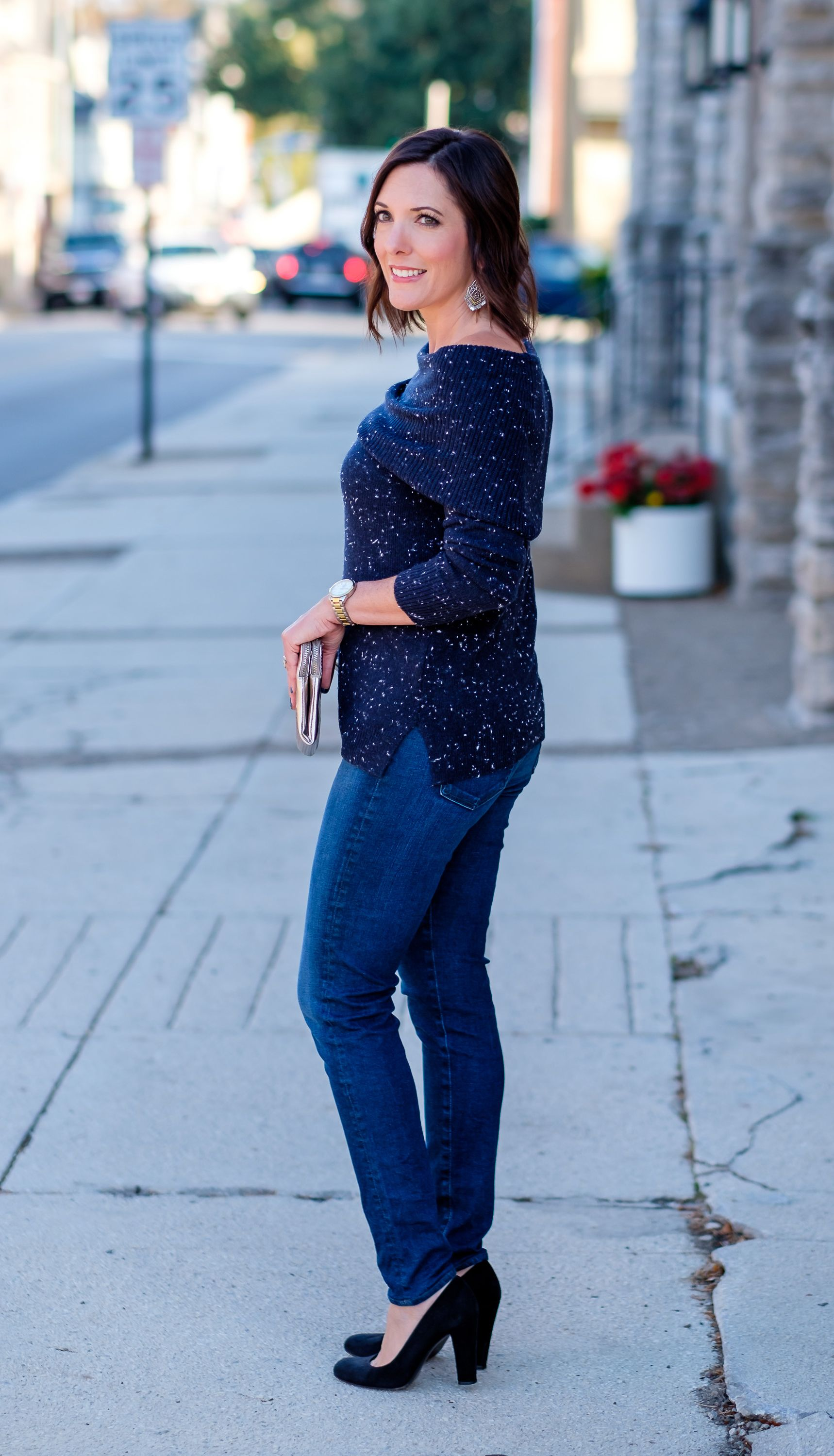 303c2070d2f Jo-Lynne Shane wearing a casual fall off-the-shoulder sweater outfit with a  navy flecked off-the-shoulder sweater