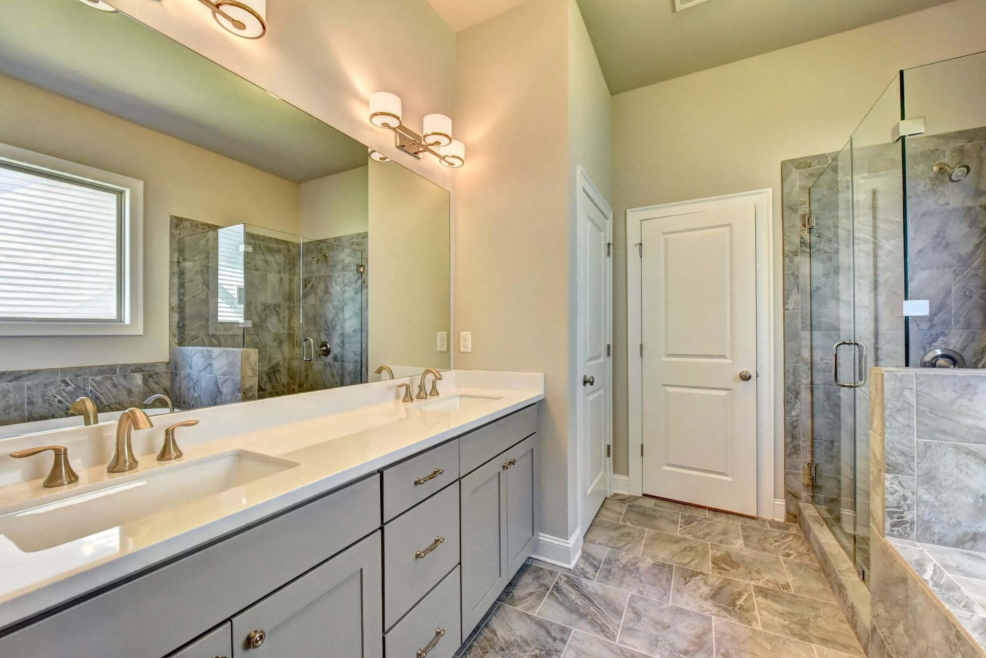 This Amhurst master bath features our Cambria