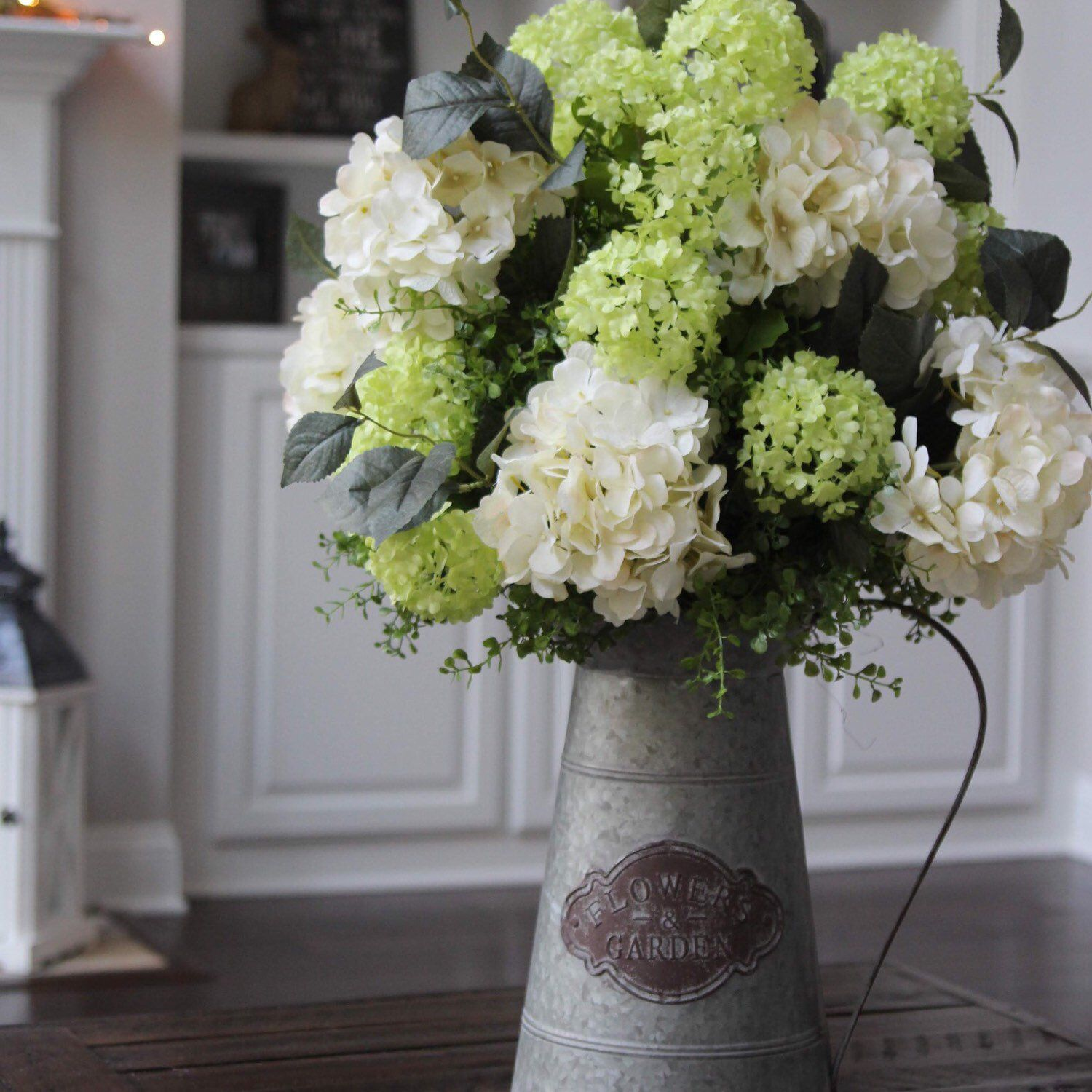 Green And Creamy White Hydrangeas In A Galvanized Pitcher With