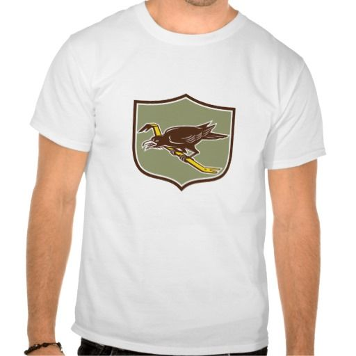 Crow Perching Crowbar Crest Retro Tee Shirts. Illustration of a crow bird perched on a crowbar viewed from the side set inside shield crest on isolated background done in retro style. #Illustration #CrowPerchingCrowbar
