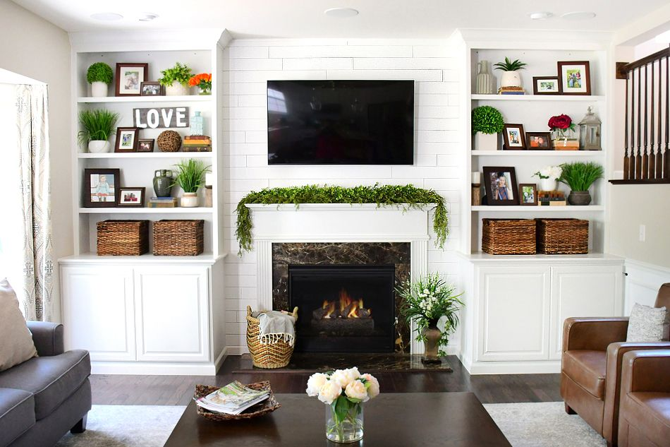 Photo of Family Room Makeover with White Built Ins and Charcoal Couches