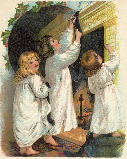 Three young children hand their Christmas stockings on the fireplace mantle in this vintage Christmas image.