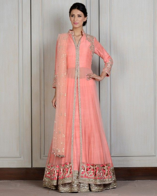 597fcae61ed2ac This Peach front open nehru collar net jacket with zardozi embroidered silk  yoke. Contrasting orange