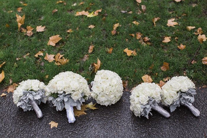 White roese bouquets wrapped in silver ribbons for A Big Fat Greek Winter Wedding | I take you