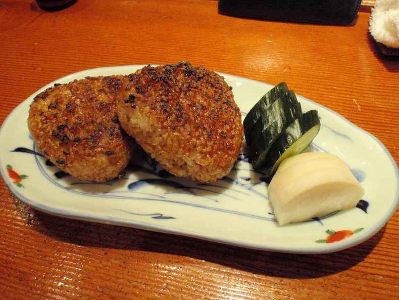 Yaki Onigiri Onigiri rice balls grilled with soy sauce and butter until crunchy.