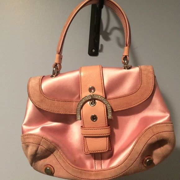 Coach pink satin and suede handbag Adorable pink satin coach handbag, beautiful rhinestone buckle snap closure, sides unsap to make a wider inside. Metal feet on the bottom zippered pocket inside. Some wear and tear but the suede hides it. Coach Bags
