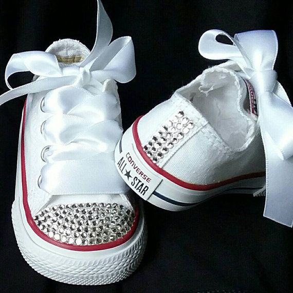 2425bf86a41b White Converse sneakers with tons of crystals on them. You choose during  check out if you want the toes done only