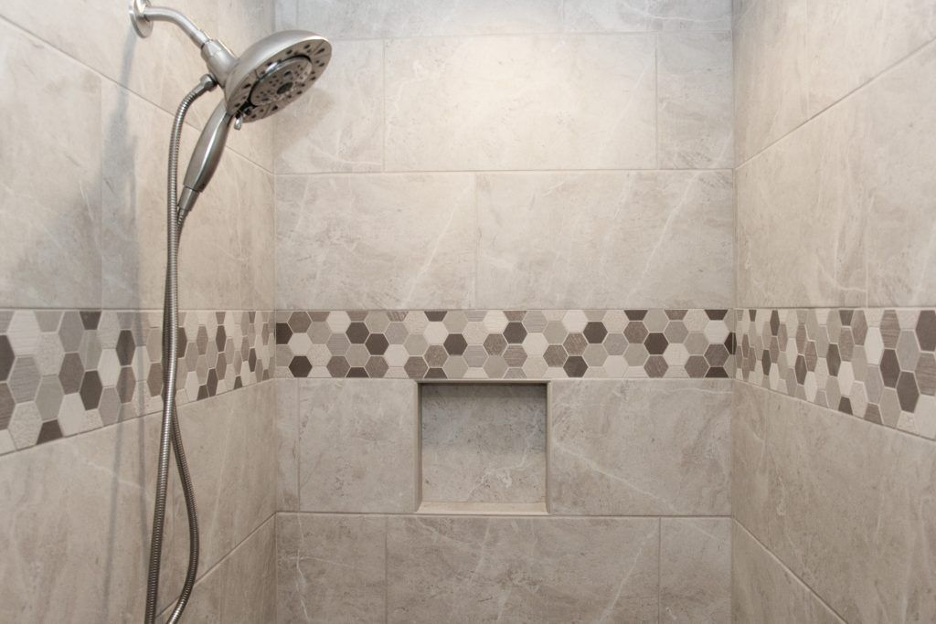 Gray Tiled Shower with Hexagon Tile Accent Strip | Gray ...