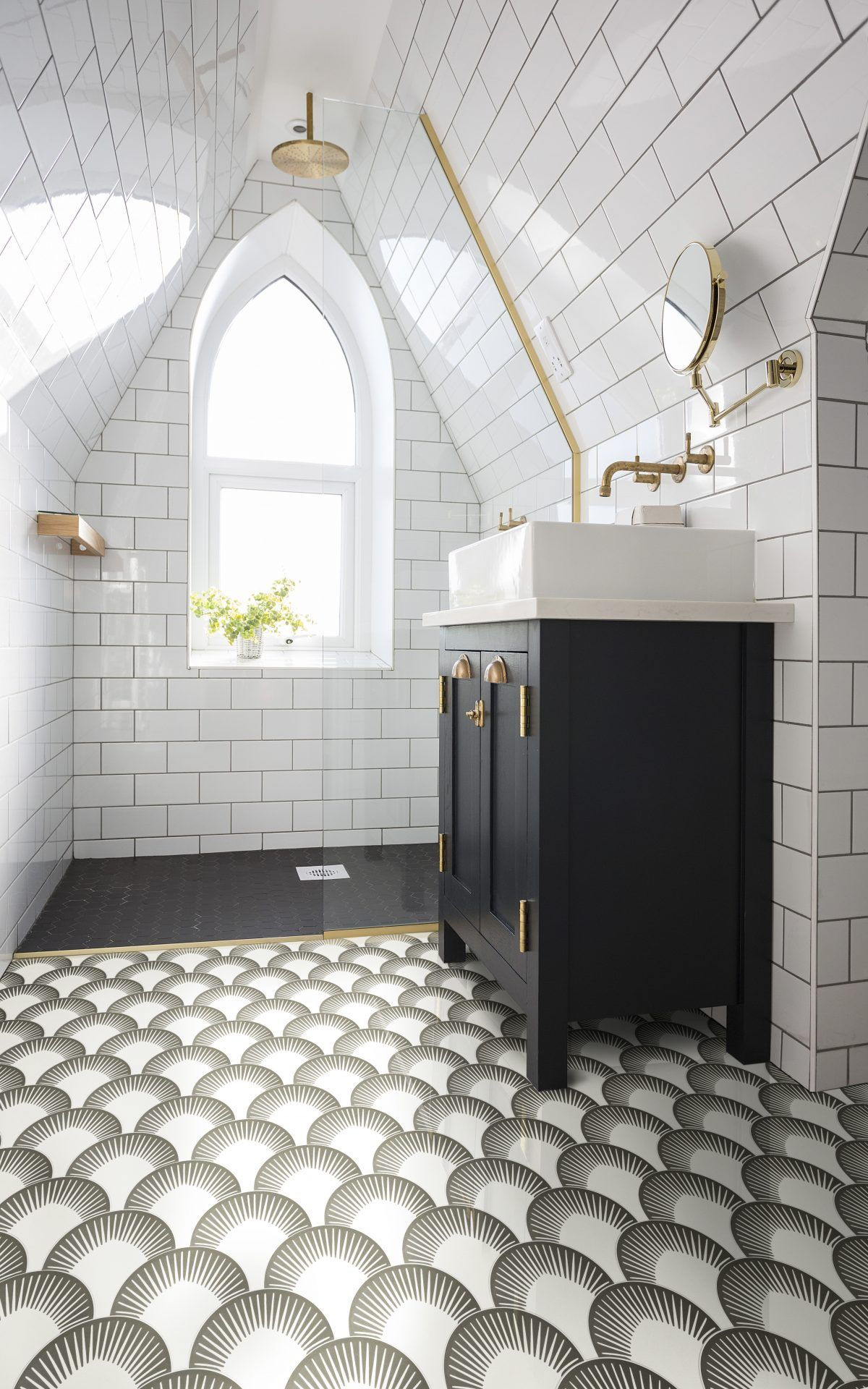 Vaulted Ceiling And Arched Window Make This Shower Space So Dreamy The Tiles And Dark Sink Unit Pull It All Togethe Attic Renovation Attic Remodel Attic Rooms