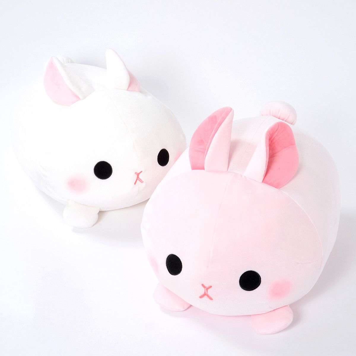 """These bunbuns are so soft that you'll want to hold them forever!  When hugged, they feel quite light and springy even though they're well stuffed. Choose between the pink peach colored Momo-pyon bunny or snow white Yuki-pyon bunny. Both have their cute little feet splayed out beneath them, perky ears, embroidered expressions, and blushed cheeks. ♥ Their big size (10.6"""" x 11.8"""" x 17.7&quo... #tokyootakumode #plushie"""