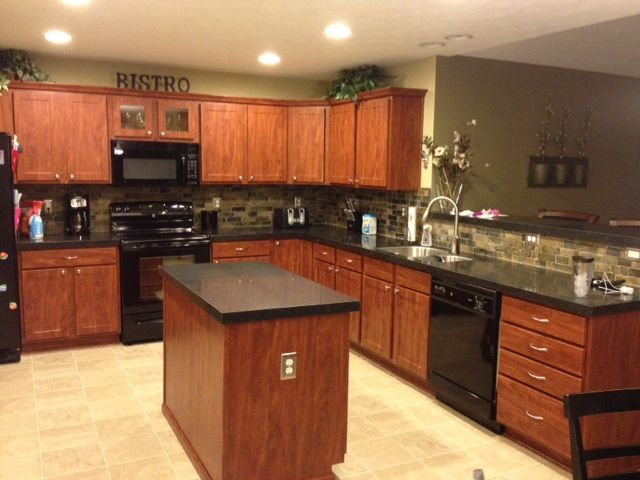 My new kitchen!! LOVE!! Thank you Granite Transformations (GT)!  Cabinet refacing and granite by GT and backsplash (Mongolian stone) came from The Tile Shop. :)