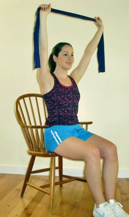 lateral pull resistance band seated workout girl working out in a chair exercise fitness shoulder muscles  sc 1 st  Pinterest & Exercises You Can Do At Your Desk | Pinterest | Shoulder muscles ...