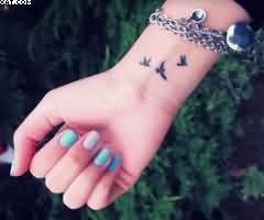 3 Tiny Birds Tattoo On Wrist Ideas And Designs Tiny Bird Tattoos Wrist Tattoos For Women Bird Tattoo Wrist