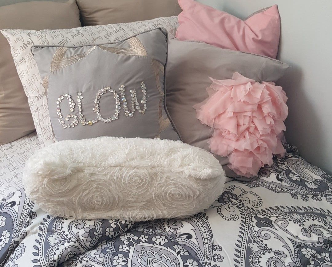 The white pillow is made from an old skirt; the gray