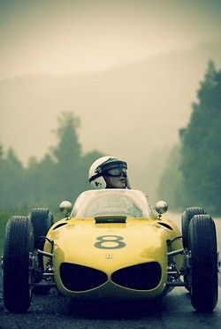 ferrari 156 Sharknose and driver in the rain