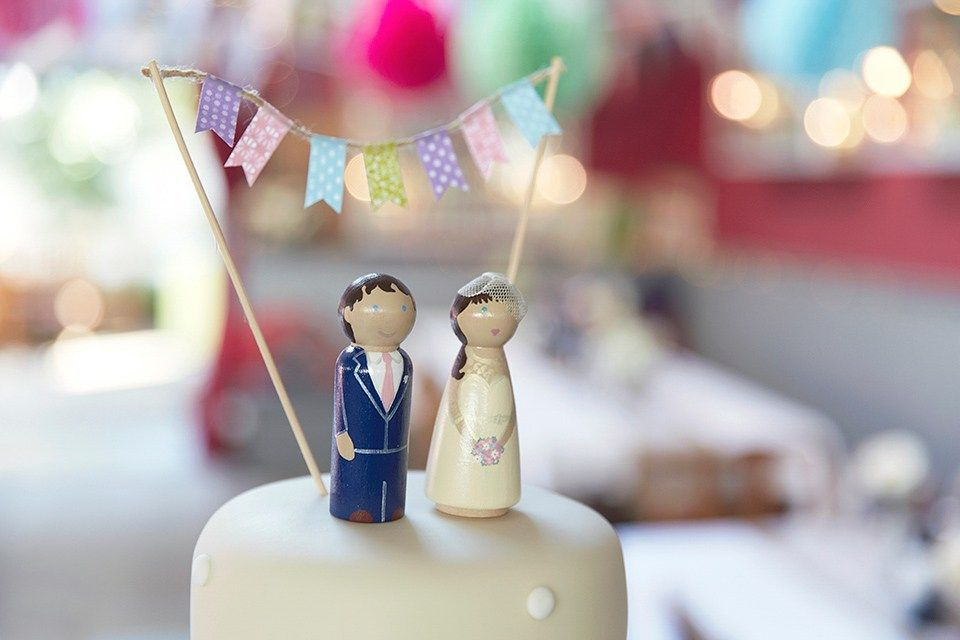 Bespoke wooden doll cake toppers . Photography by http://www.nataliejweddings.com/