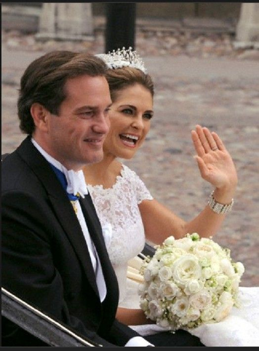 Swedish Princess Madeleine and her husband Chris O'Neill drive in a carriage from the Royal Palace to Riddarholmen after their wedding in Stockholm, Sweden, 08 June 2013