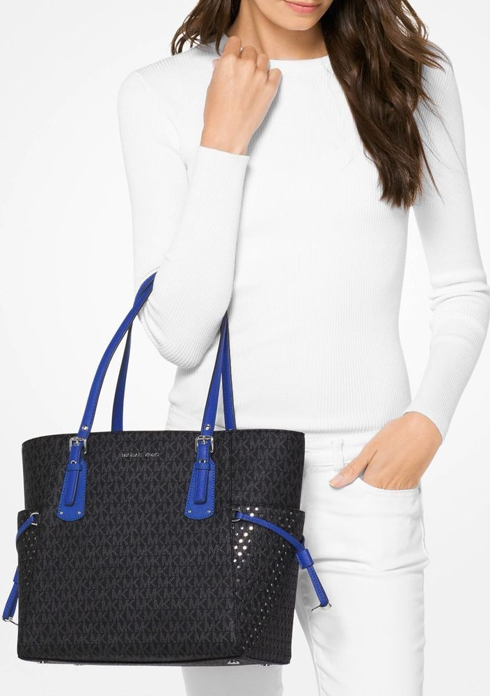 d601f378d41c ... real michael kors voyager ew signature tote black electric blue nwt  womens designer fashion hand bags