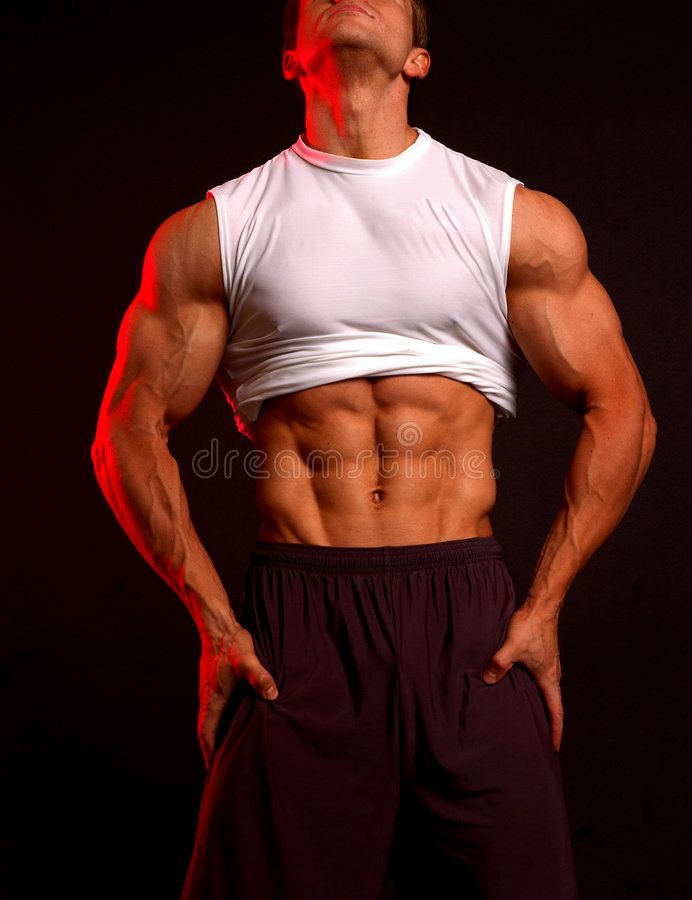 Fitness model in white. Muscular fitness model in white shirt and black sweats, , #sponsored, #Muscu...