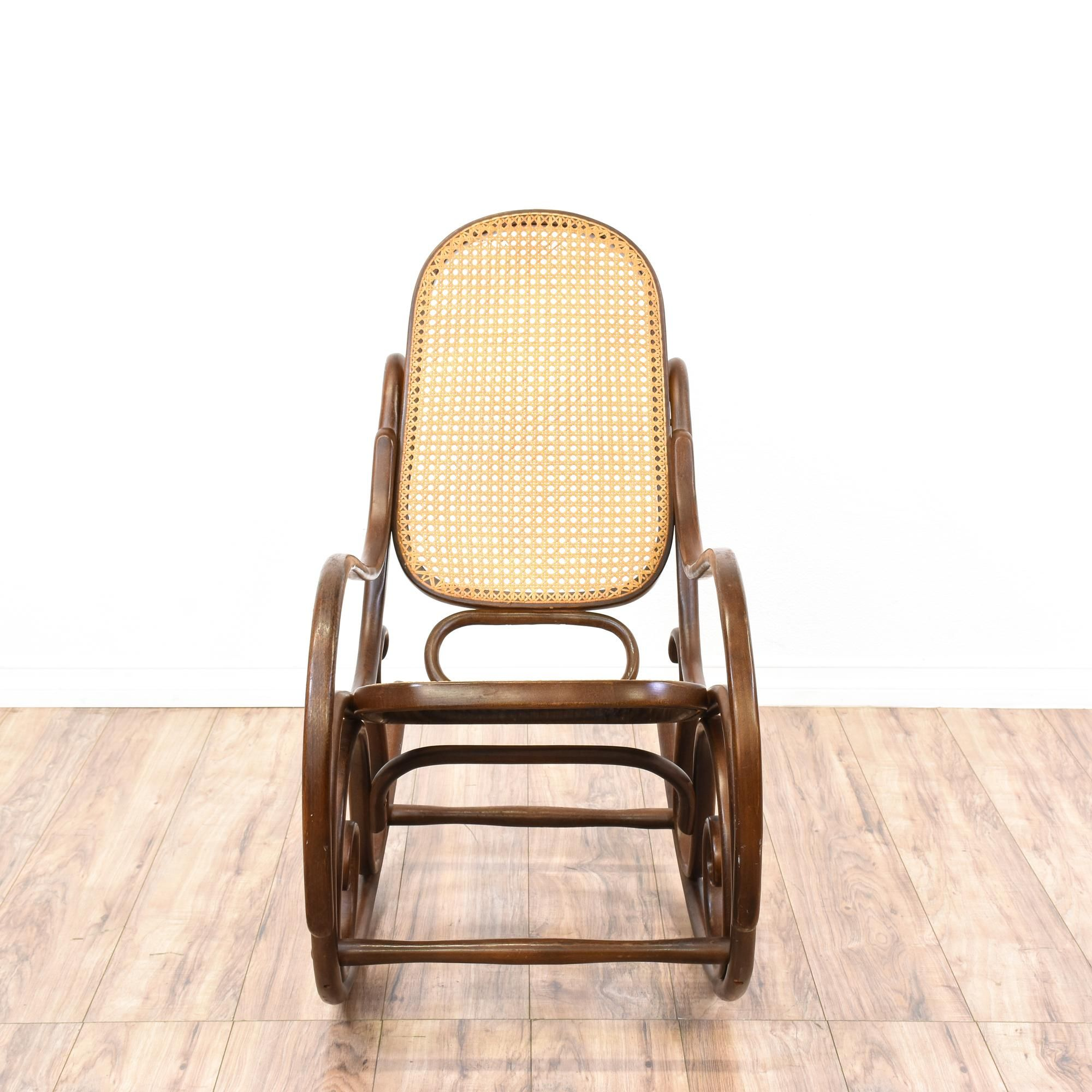 This rocking chair is featured in a solid wood with a glossy