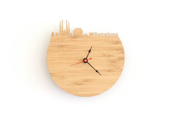 What time is it in Barcelona? This is a modern clock featuring the Barcelona skyline. It features the Casa Mila, Sagrada Familia, etc. You can set it to