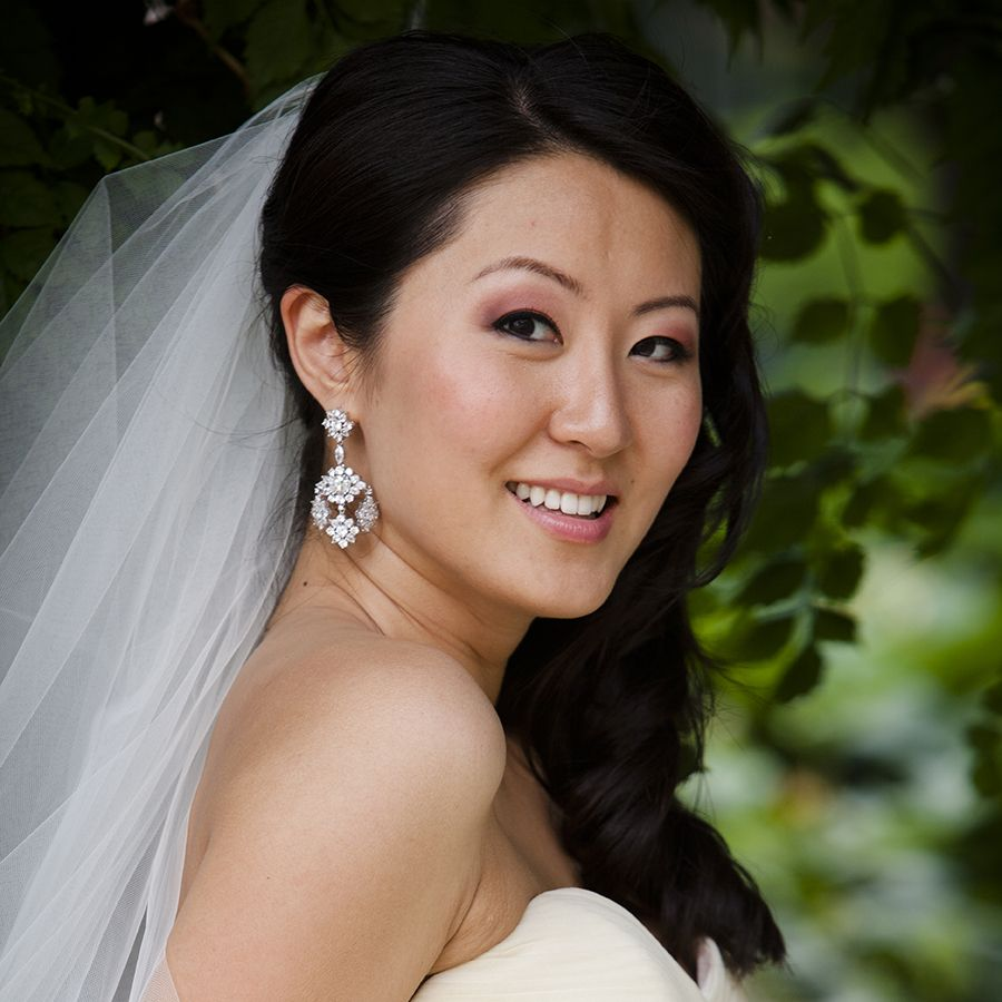 Stunning hair style with chandelier earrings.  #Bride #Wedding #Marriage #Dress #White #Earrings #Vail #Tree #Outdoors #Outside