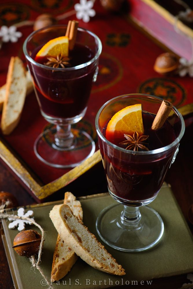 Mulled Wine (Vin Chaud) - wine simmered with apple cider, honey, cinnamon, orange, cloves and anise. Food photography by Paul S. Bartholomew.