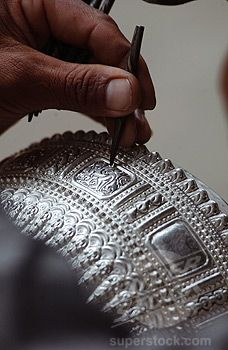Detail of craftmanship found in silversmith Thithpeng Maniphonein's studio. Putting his own stamp on it.