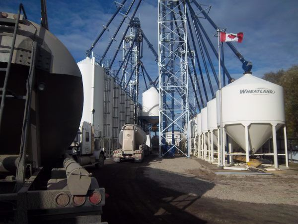 Pneumatic trailers loading frac sand at a typical transloading